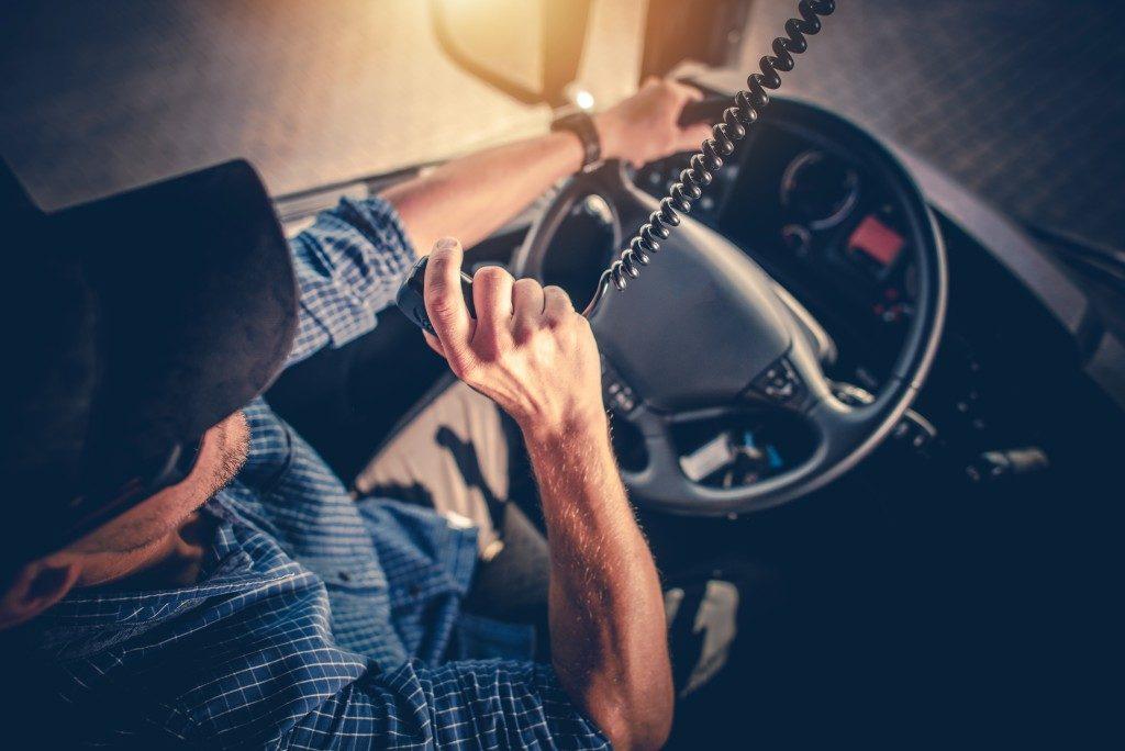 truck driver using radio