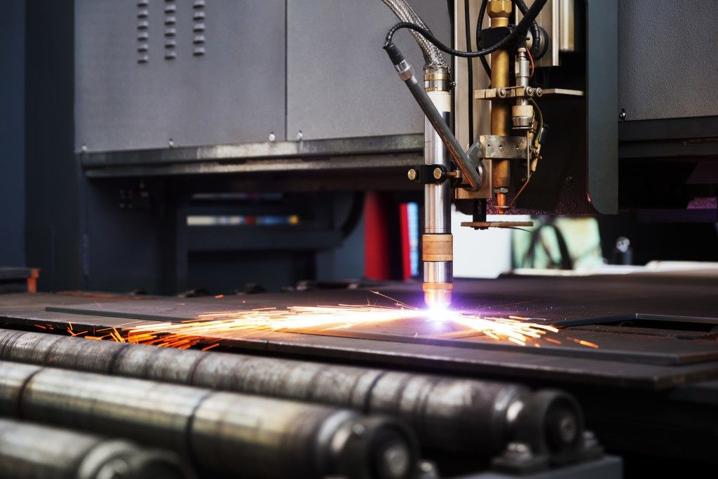 Laser cutting a metal plate