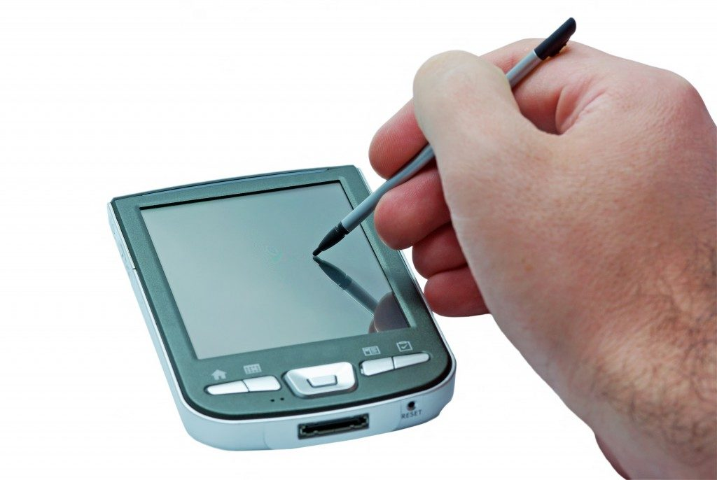PDA phone with touch screen and stylus in hand