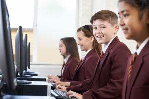 Pupils Wearing School Uniform In Computer Class