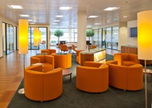 Retro themed office lobby with many chairs