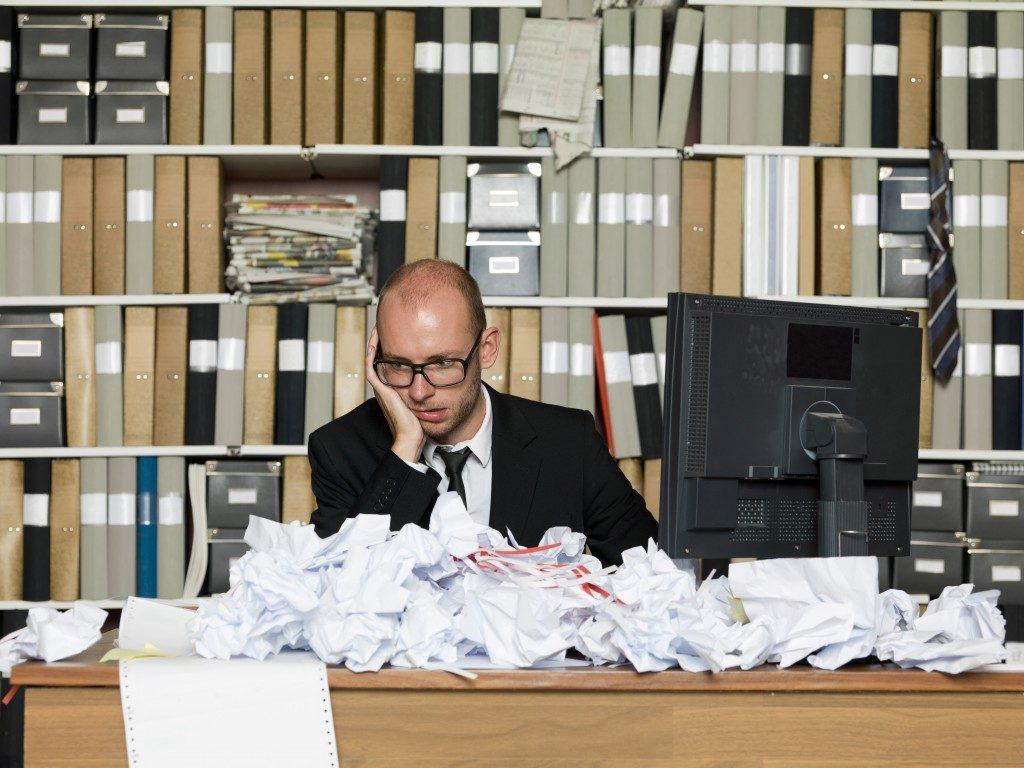 Desk of employee full of trash