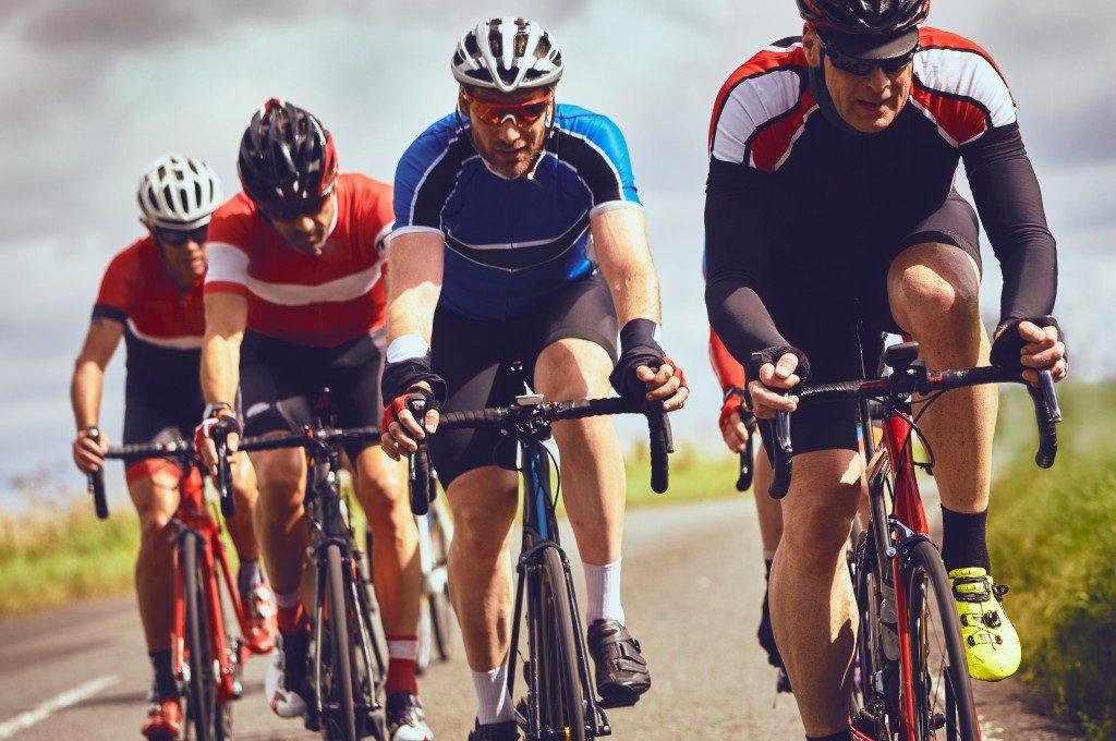Four men cycling