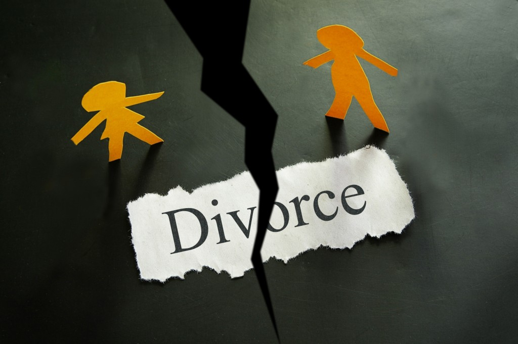 torn piece of paper with divorce text