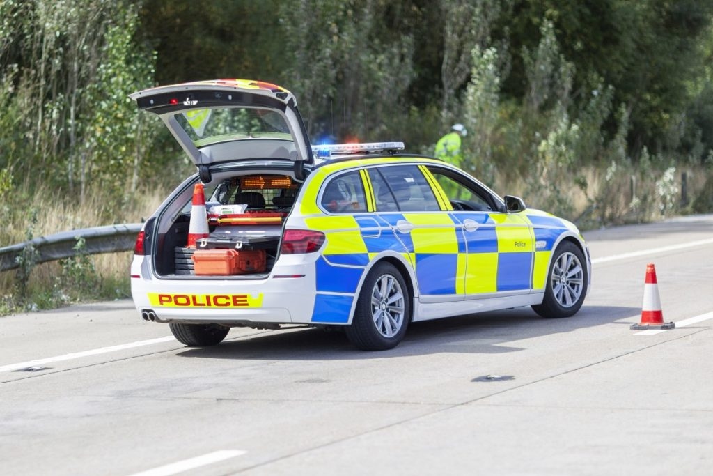 Police car at motorway accident or crime scene