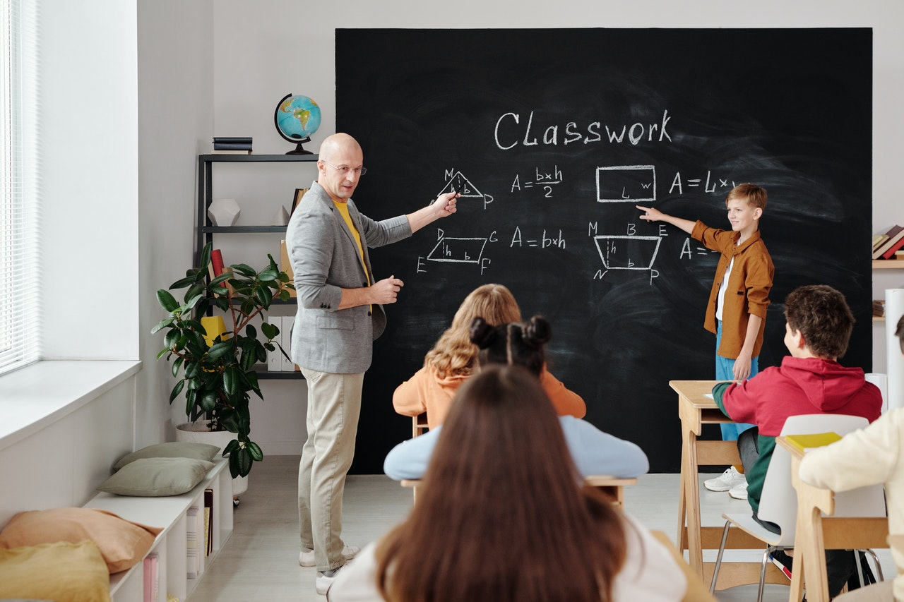 teachers with their students