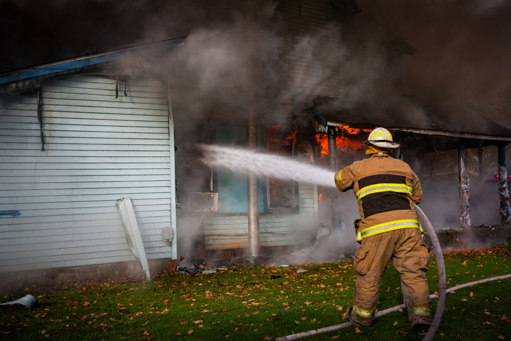 fire fighter putting out fire