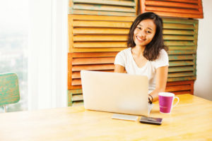 woman happily working